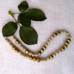 Modern method rose bead necklace with gold pearls.